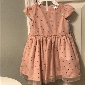 BRAND NEW Carter's Dress. Size 12 months.